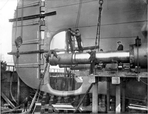 In this remarkable photograph, taken in May 1911, shipyard men are fitting Titanic's starboard tail shaft. source