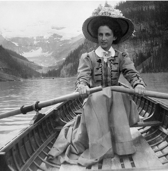 Woman rowing on Lake Louise, Alberta, Canada. Circa 1910.