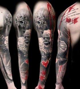 Horrific clown full arm tattoo