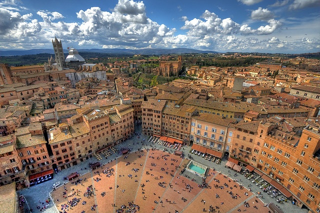 HDR view of Siena from the Torre de Mangia. The Piazza del Campo is at the bottom, and the village's duomo with it's striped belltower can be seen at 10 o'clock.