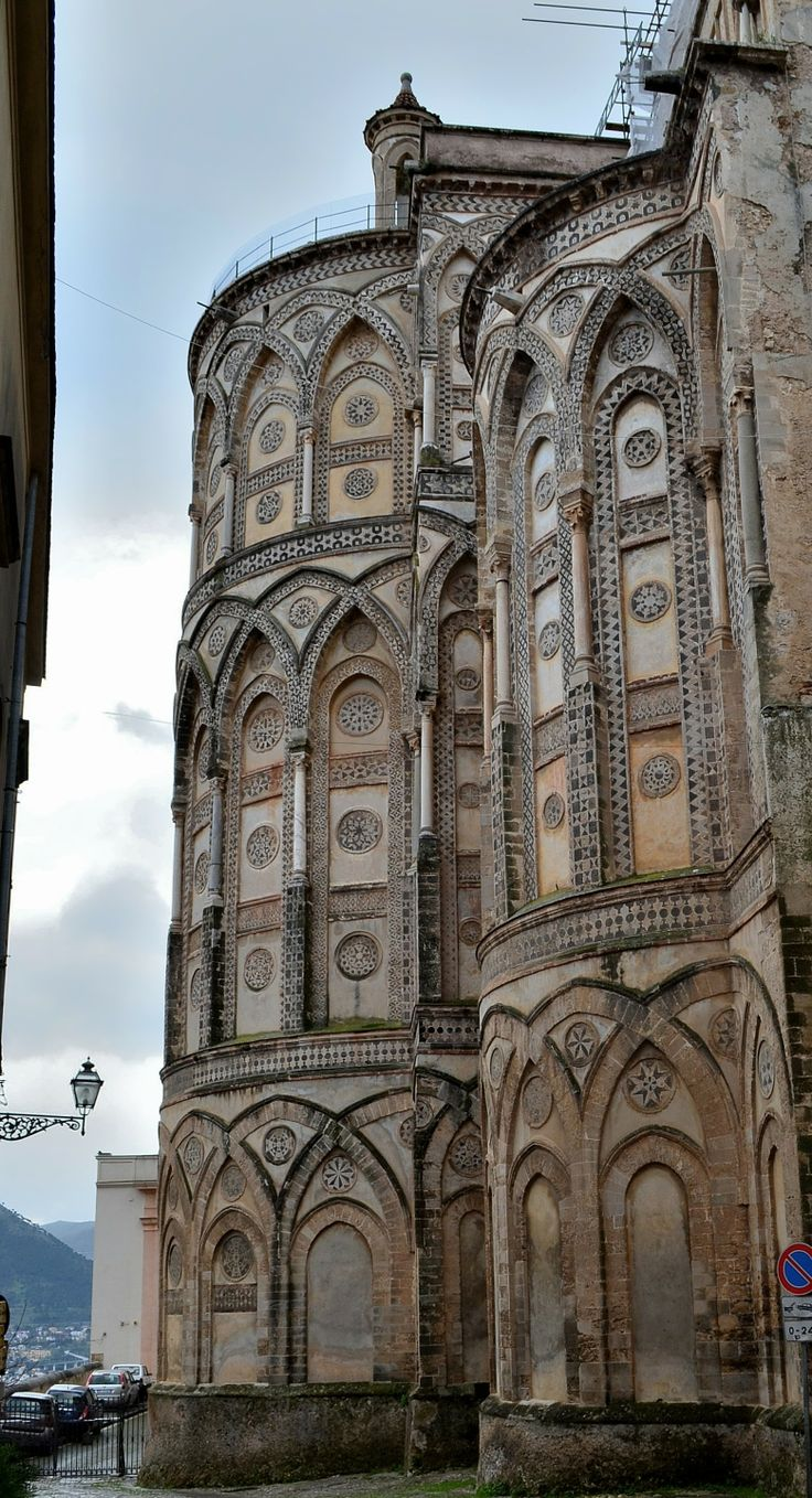 LATE BYZANTINE ARCHITECTURE -  The  Cathedral of Monreale, near Palermo, begun 1174 .  The exterior of the apse is decorated by blind arcading of small crossed arches in arabesque style. other styles such as Norman and gothic were also used.