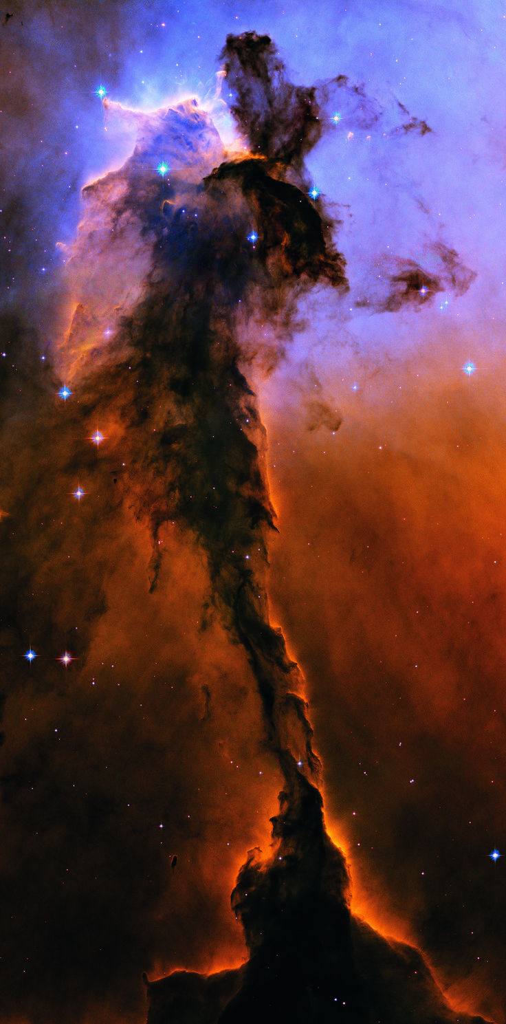 This object is actually a billowing tower of cold gas and dust rising from a stellar nursery called the Eagle Nebula. The soaring tower is 9.5 light-years or about 57 trillion miles high, about twice the distance from our sun to the next nearest star.