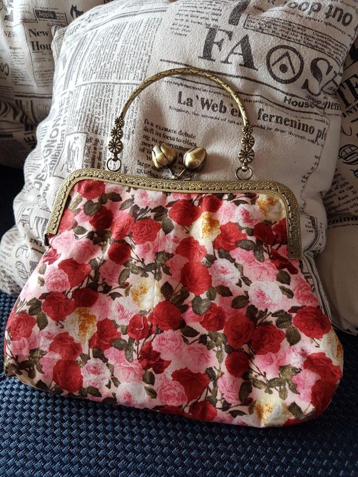 Vintage kiss-lock bag entirely handstitched