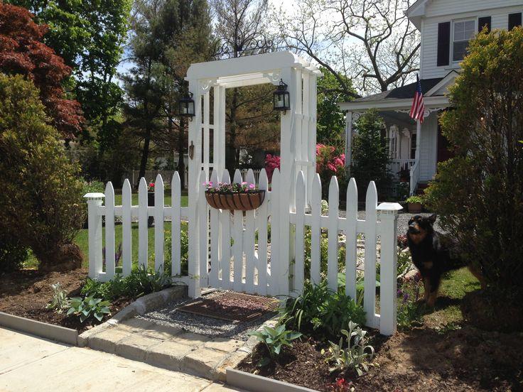 White picket fence garden gate and arbor White picket