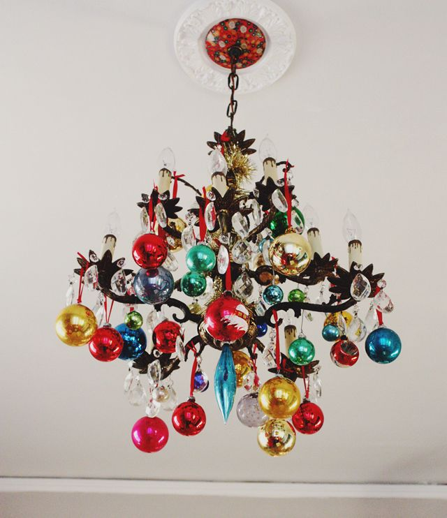 vintage ornaments hung from chandelier #christmas