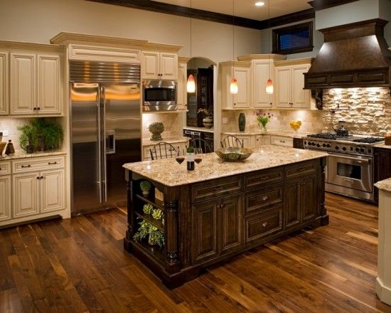 Gorgeous kitchen with Walnut hardwood floors!  green colors used in the accessories - great contrast.