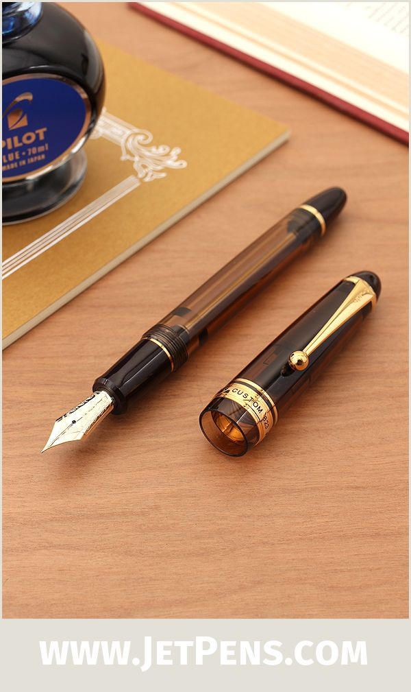 The Pilot Custom 823 Fountain Pen Gift Set includes an amber-colored, self-filling demonstrator and Pilot Blue fountain pen ink.