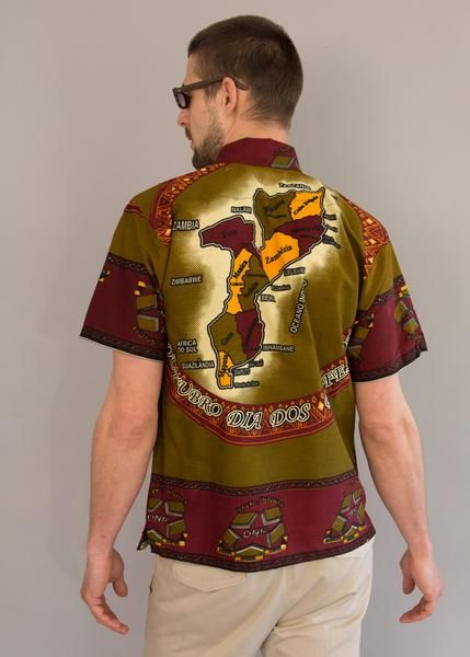 70s short sleeve casual shirt. Bold print of a map of Africa in burgundy, olive green, and mustard, side slits