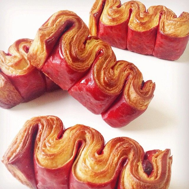Our new Holiday Ribbon croissant borrows inspiration from Old Fashioned Ribbon Candy. A vibrant raspberry crust encases flaky croissant curls filled with cherry, raspberry & cassis pastry cream. Available in stores for a very festive limited time!