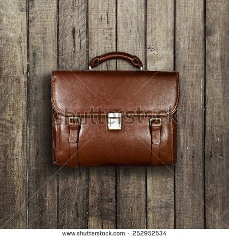 briefcase on a wooden shabby background