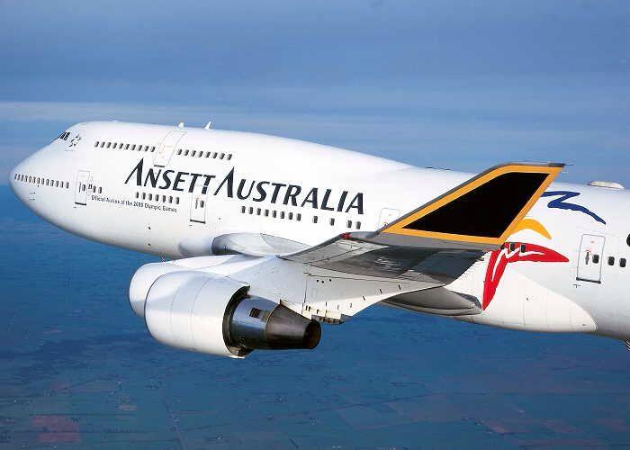 Ansett Australia Boeing 747-412 (VH-ANA) in the 'Starmark' livery with 'Sydney 2000' titles, September 1999.