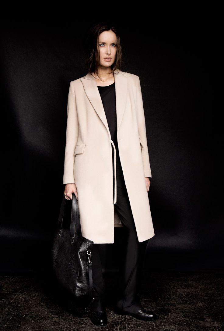 Tailored coat, black top, black trousers and textured leather bag, all Carolyn Donnelly The Edit