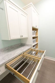Laundry room drying racks and basket storage