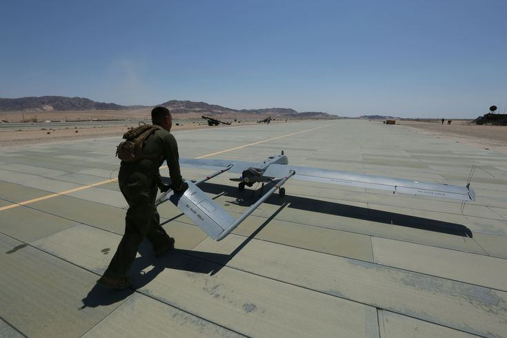 Lance Cpl. Miguel Salazar, a UAV technician with VMU-4, returns an RQ-7B Shadow to the hangar at Camp Wilson, MAGCC Twentynine Palms on June 22, 2017. (Courtesy photo)