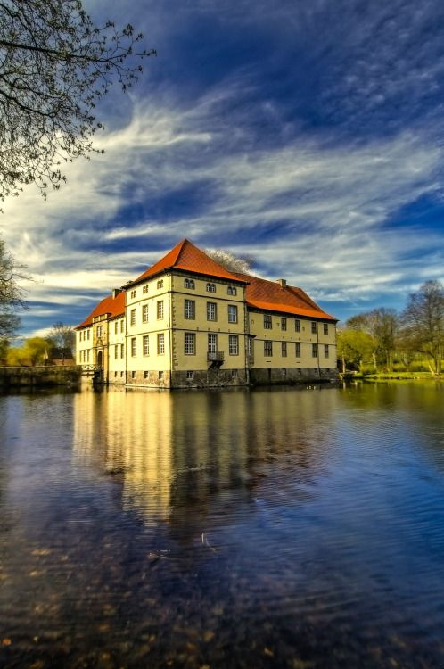 Das Wasserschloss Strünkede in Herne, Nordrhein-Westfalen, Northwestern Germany.The moated palace is one of the nicest palaces in the Ruhr Area. The palace chapel was constructed by Bernd von Strünkede in 1272, and is the oldest preserved structure in Herne today. At the museum, visitors can see an interesting collection of Biedermeier furniture, mammoth bones, ceramics, and valuable timepieces.