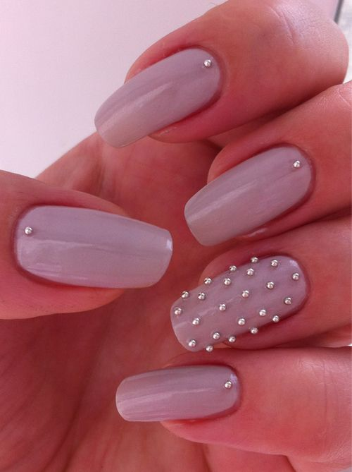 We love these pretty Lavender nails with mini silver stud detailing #nailart
