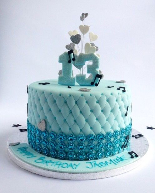 Fondant quilting and musical notes with glittery duck egg blue heart topper and number 13 by Karen's Cakes.