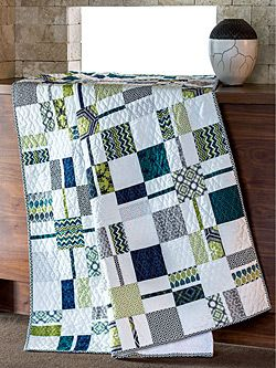 This white quilt pattern is perfect for creating a simple look in your DIY decor that is both traditional and modern all at one time!