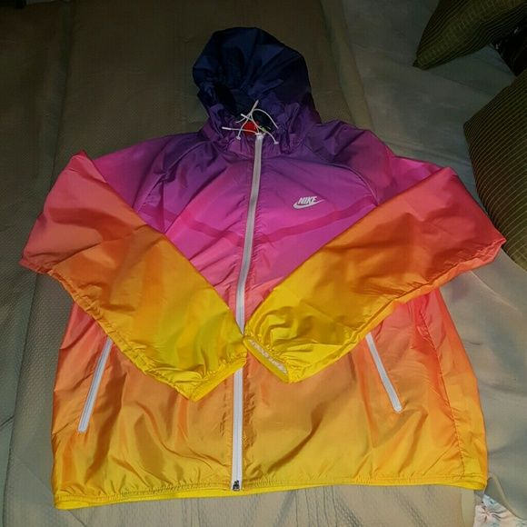 Final price: Sunset MultiColor Ombre Windbreaker Men's large. Can fit women depending on how big you want it to be. New with tags. Originally $150. Amazon has 3 left and is selling for $180 plus $9 shipping. This is a great deal. Feel free to make an offer. The colors are blue, purple, pink, orange, and yellow. Nike Jackets & Coats