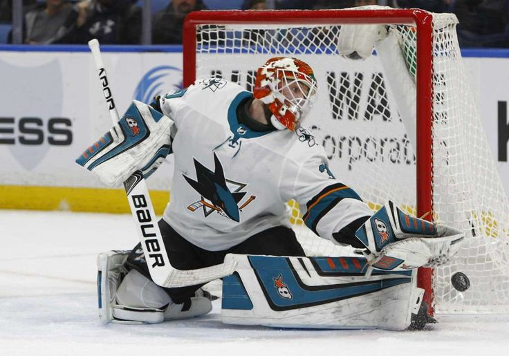 San Jose Sharks goalie Aaron Dell (30) makes a save during the first period of an NHL hockey game against the Buffalo Sabres, Saturday Oct. 28, 2017, in Buffalo, N.Y. (AP Photo/Jeffrey T. Barnes)