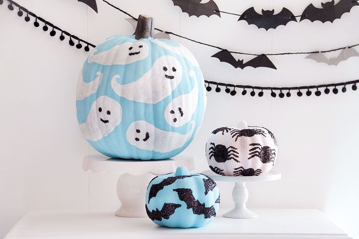 Why carve when you can paint, glue and sparkle your way to the most beautiful pumpkin decor around?