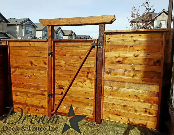 Inside view of a Horizontal Style fence and gate. Gate has a Z Brace for strength. www.dreamdeckandfence.ca