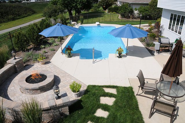 Vinyl Pool with paver brick retaining wall and fire pit done by All Seasons Pools and Spas in Orland Park, IL