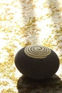 beautiful simple spiral painted on beach rock