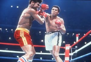 This brutal photo of Leon Spinks' contorted face communicates the power of Ali's punch. Ali's expression is also compelling – he looks somewhat savage. Technically the framing is awkward. I would prefer it if Spink's face weren't at the very edge of the frame, but it's hard to grumble with such a visceral shot.