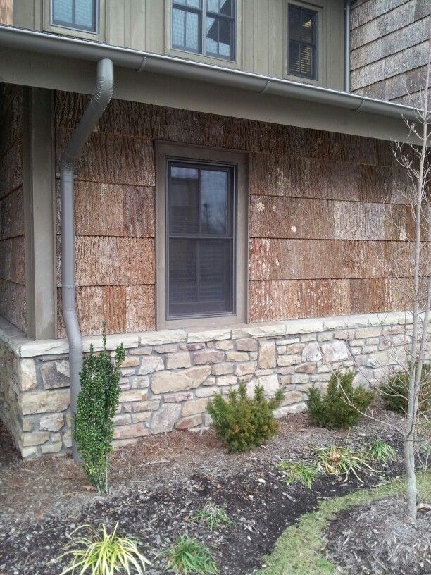 Vertical siding with wood siding and stone poplar bark for Bark house siding