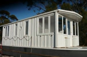 Image result for floating shipping container houseboat