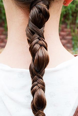 Braided pieces coursing through a low ponytail offers a spirited take on the standard. // #Hair