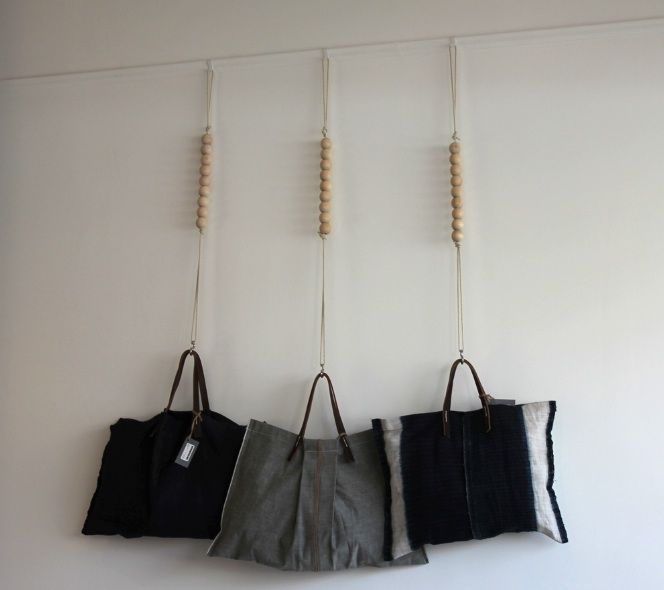 I'm going to make these hangers for my outdoor craft show - perfect for hanging pillows from a tent! Photography by David John of You Have Been Here Sometime.