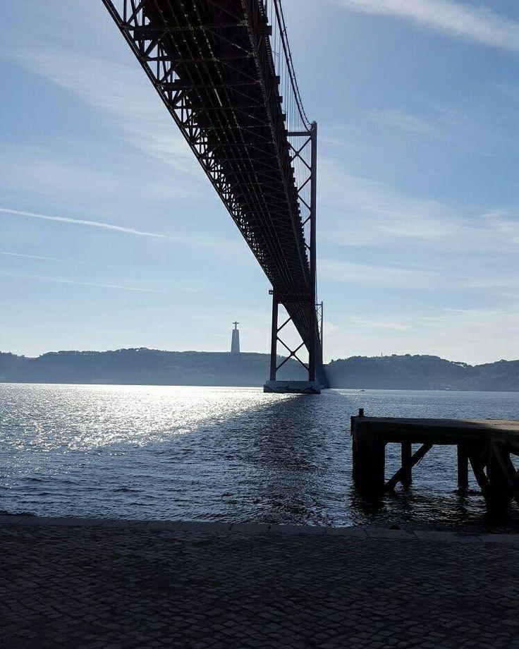 Lisbon bridge sun and shadow