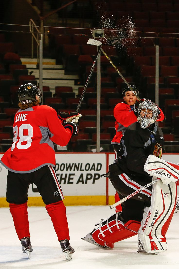 Patrick Kane and Andrew Shaw battle for the puck. please follow me,thank you i will refollow you later
