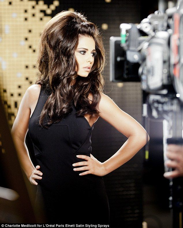 Cheryl Cole brings back her big hairtsyle as she does a photoshoot for L'Oreal.     Image courtesy of the Daily mail.     Copyright Charlotte Medlicott for L'Oreal Paris Elnett Satin Styling Sprays.