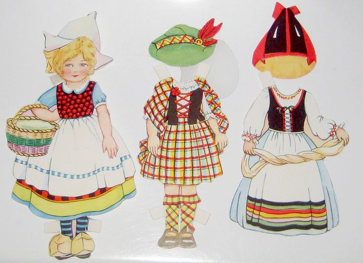 "Traveling Dolly Paper Doll Costumes Vintage Valentine Paper Doll Probably 1920's ""This little dolly has traveled far, and now she's come to see where you are."" Doll wearing Netherlands costume with Scottish and Swedish outfits. (Pennelainer)"