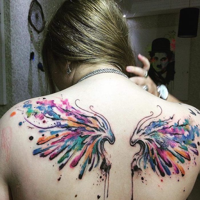 Wings Chest Tattoo Watercolor Tattoo Woman With Blonde Hair Silver Necklaces In 2020 Broken Wings Tattoo Wings Tattoo Wing Neck Tattoo