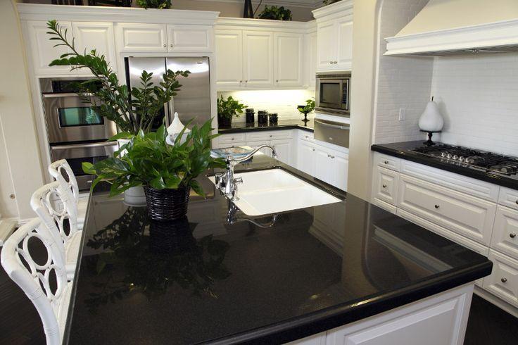 Black quartz counter top in kitchen