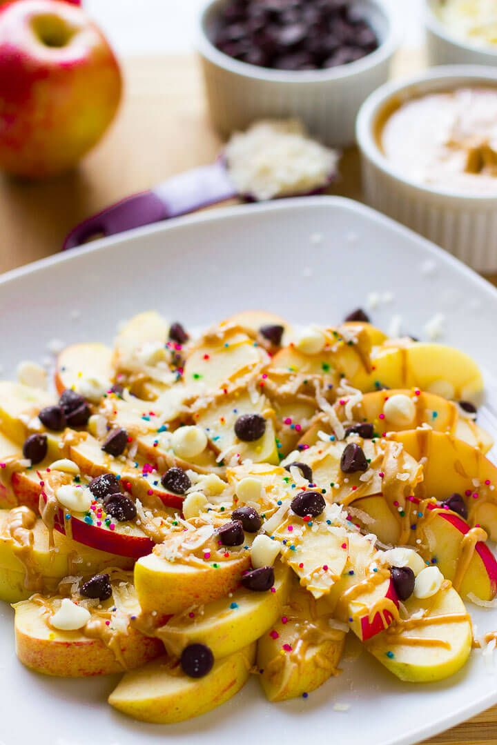 Loaded Apple Nachos Recipe ~ Easy to make, delicious and crisp and a great quick dessert! Loaded with Peanut Butter, White Chocolate, Chocolate Chips & Coconut! on MyRecipeMagic.com