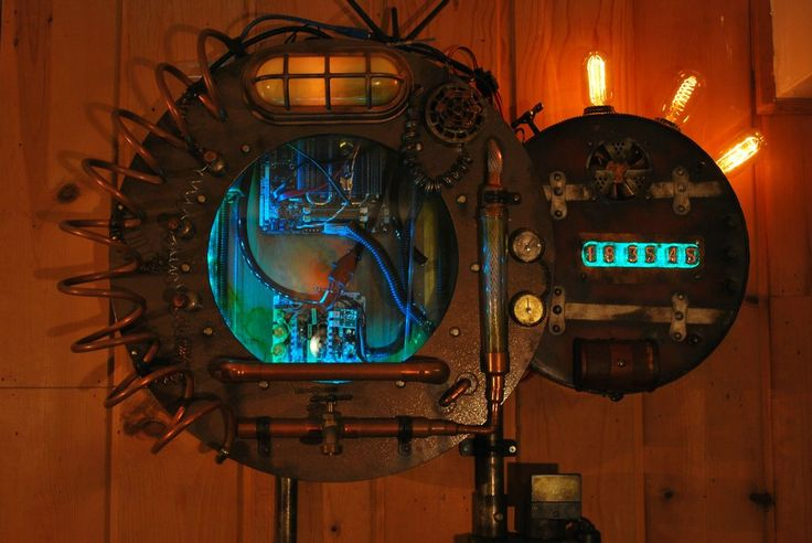 """Absolutely STUNNING """"Nautilus Reactor"""" home theater computer with built-in Nixie tube clock. Hit the link for the full gallery of build photos."""