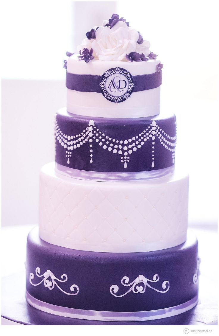 classy colors and style - purple and white wedding cake