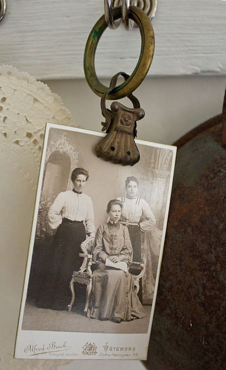old curtain clips. what a great way to display old family photos