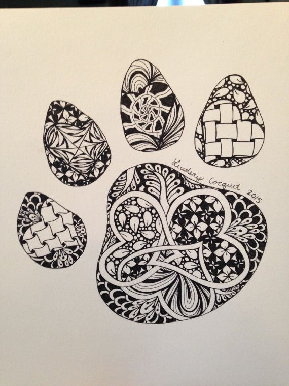I think this idea would be cool, with a zen tangle of all my favorite things inside the paw print.  (4 leaf clover, heart, seahorse, etc).