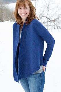 This geometric-inspired cardigan uses simple ribbing insets and angled fronts to create a striking silhouette. Knit from the top- down using the contiguous set-in sleeve method, there are no seams to sew. The deep ribbed collar adds a comfy touch to the dramatic cardigan shape.