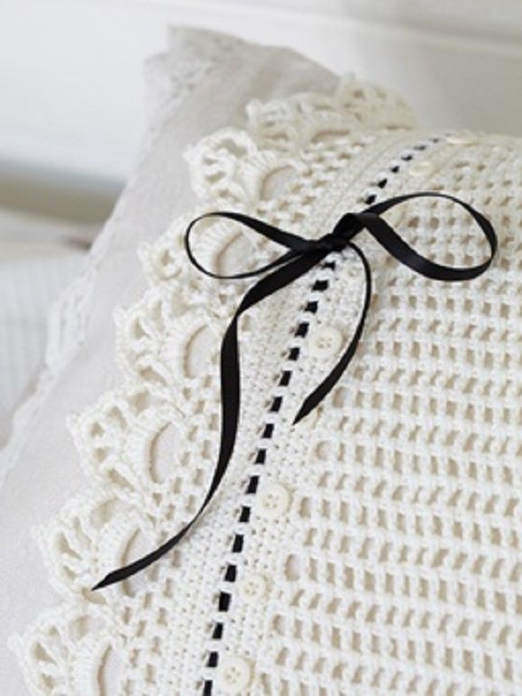 Love this crocheted pillow cover.  You could change the ribbon for holidays.