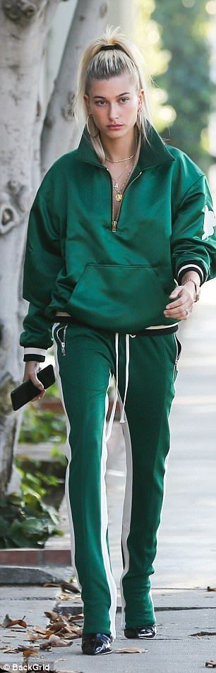 Model behavior: Hailey Baldwin, 20, accessorized a recent outfit with patent leather shoes...