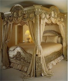 Canopy bed. Crazy. Looks like it belongs in a movie, another century, our in a doll house. Amazing detail though, so hats off to the master craftsman who built it!