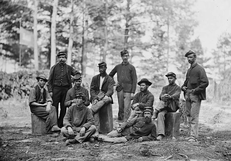 the usual motley crew of back-chainmen and level rod-holders taking a smoke break, no doubt, and when the cameraman showed up they had to hide the pipes and cigars real fast so Mom would not see the lurid evidence of modern decadence and sensual indulgences that would usually be frowned upon at the old homestead....NOTICE PLEASE: the affected looks of innocence and studied detachment on most of the gentlemen's countenances, as if nothing extraordinary was going down before the shutter was...