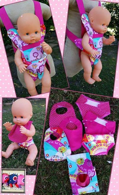 Handmade by Three Wookies Doll carrier with bib, nappies and wipes set. The carrier will fit from approx. 2-8yrs, and will fit a range of different doll and teddy sizes.